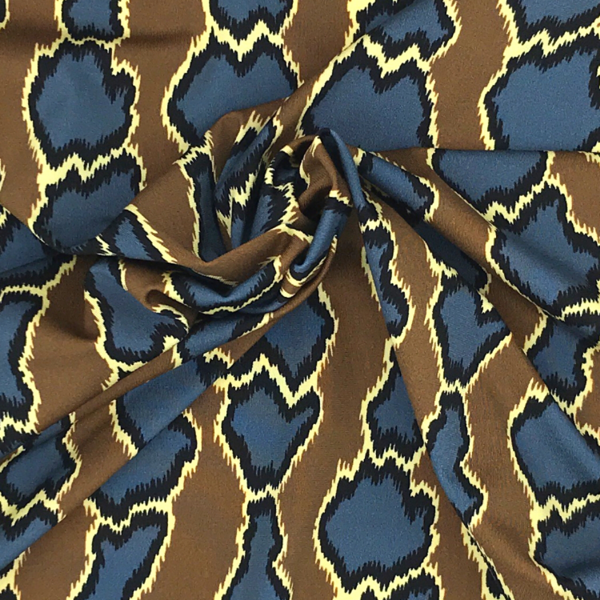 Brown, Blue, Yellow, and Black Animal Print Woven Textile by Beach & Body by Clerici Tessuto