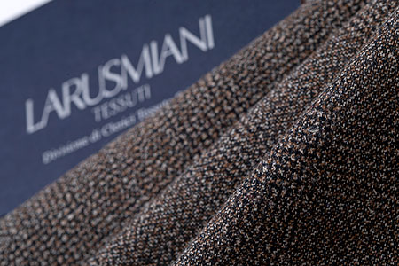 Brown, Black, and White Woven Textile with LARUSMIANI TESSUTO Logo in the Background