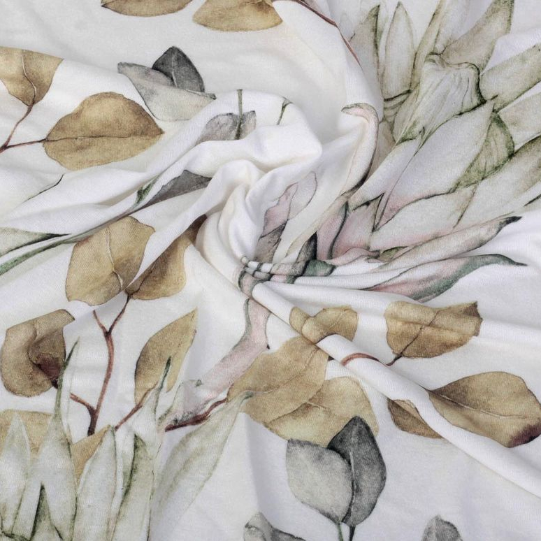 A white-background textile with a muted yellow-green leaf floral print
