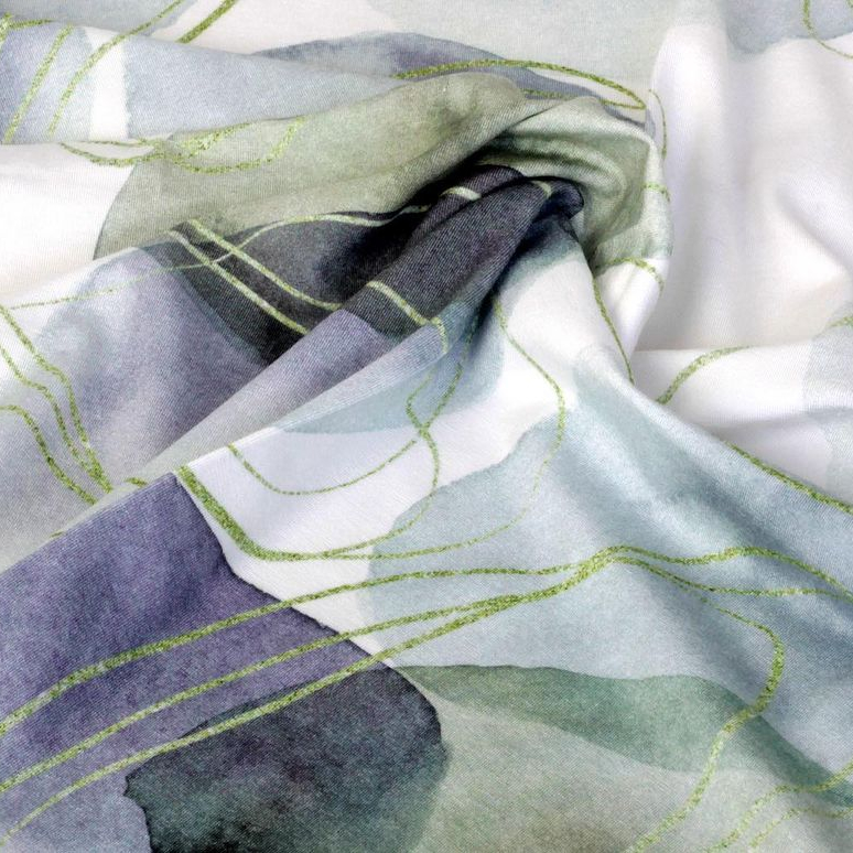 A white-background textile with watercolor textures in green, light blue, and navy, with green abstract lines by Zeynar